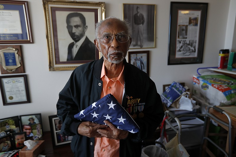 World War II veteran Johnnie Jones, Sr. poses for a portrait at his home in B...
