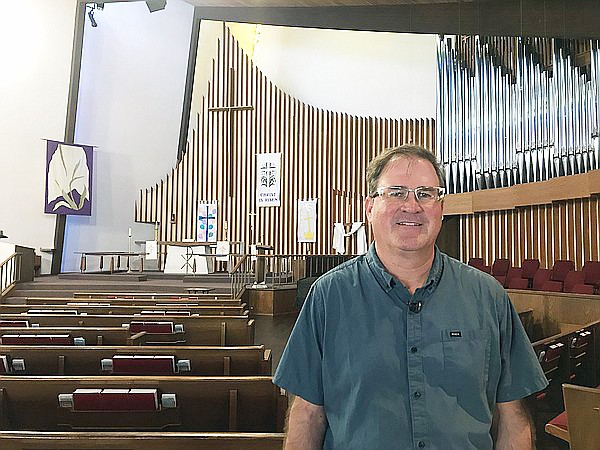 Pastor Jon Doolittle stands in the sanctuary of Clairemon...