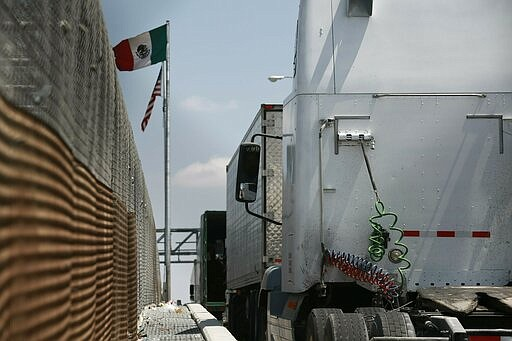 Trucks line up at the Corboba - LasAmericas international bridge to cross wit...