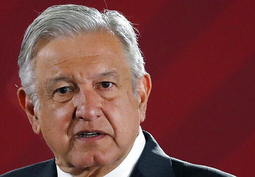 Mexican President Andres Manuel Lopez Obrador answers questions from journali...