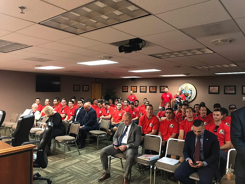 San Diego firefighters were in the City Council committee room in support of ...