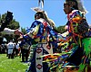 Native American dancers participate in Pow Wow ...