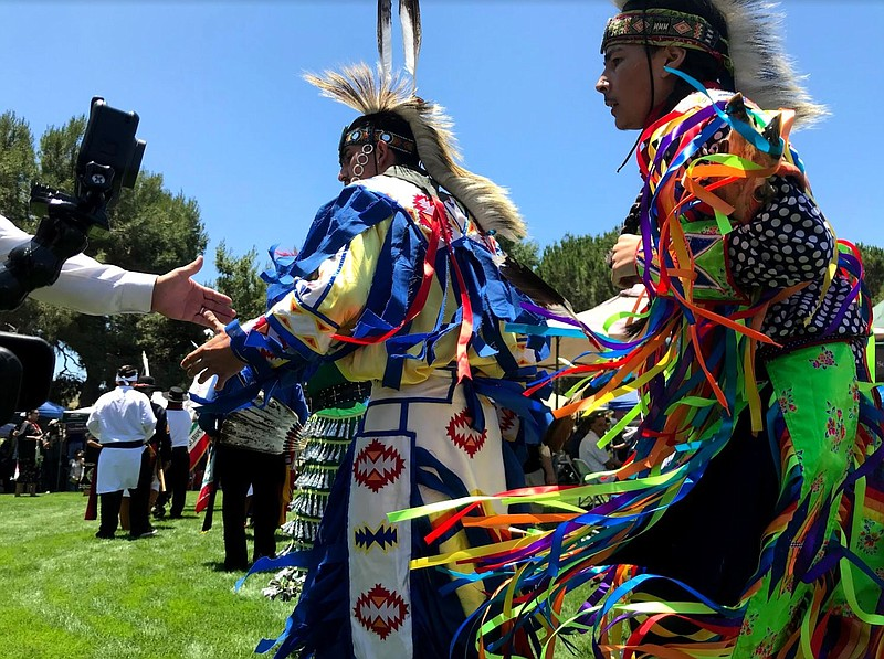 Native American dancers participate in Pow Wow at the San Luis Rey Mission gr...