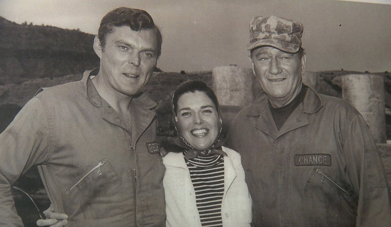Ed Faulkner (left) with his wife Barbra (center) and John Wayne (right) on th...