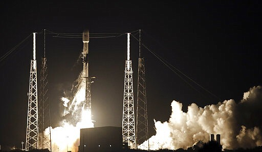 A Falcon 9 SpaceX rocket, with a payload of 60 satellites for SpaceX's Starli...