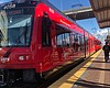 A Blue Line MTS Trolley train in Barrio Logan, ...