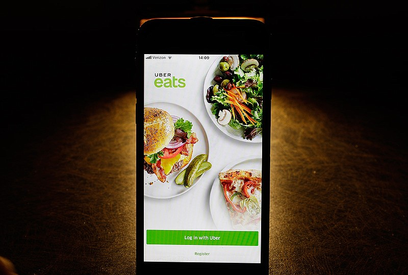 In this Feb. 20, 2018, file photo shows the Uber Eats app on an iPhone in Chi...