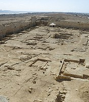 Wide aerial shot of Taposiris Magna temple ruins.