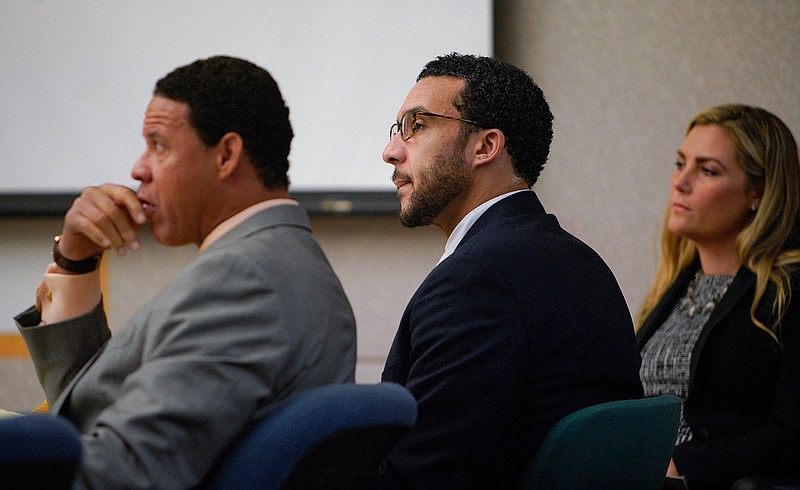 Sitting in Superior Court in Vista, Kellen Winslow, Jr., is flanked by two of...