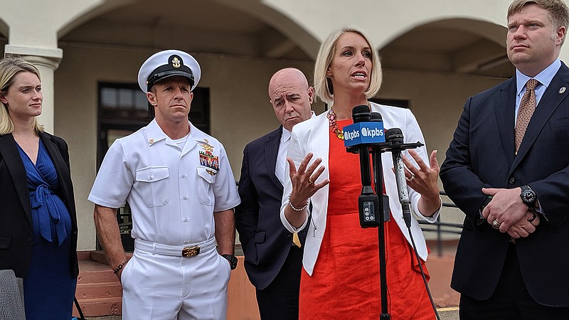 Special Operations Chief Edward Gallagher's wife addresses the media during a...