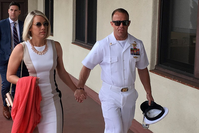 Navy Special Operations Chief Edward Gallagher, right, walks with his wife, A...