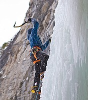 Aaron Mulkey climbing a frozen waterfall as the ice is constantly moving and creaking. He must try to pick the safest route to the top.