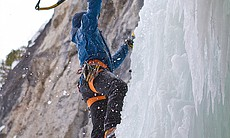 Aaron Mulkey climbing a frozen waterfall as the...