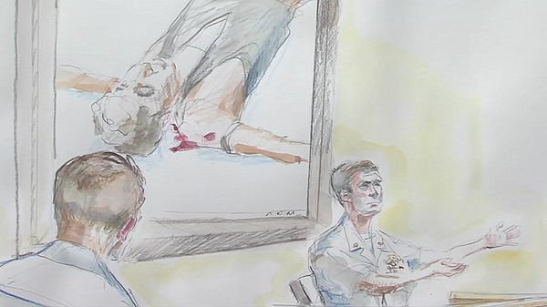 A photo of a courtroom sketch depicts the Islamic State p...