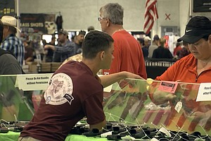 Photo for Gun Show Promoters Vow To Challenge New Law Banning Gun, Ammo Sales At Fairgr...
