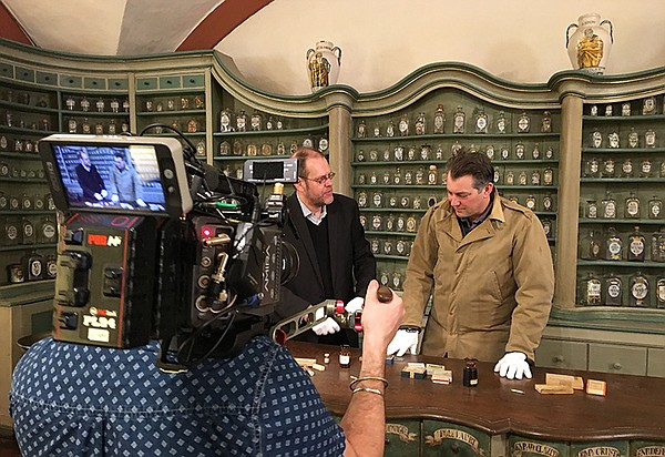 Inside the German Pharmacy Museum, James Holland (right) ...