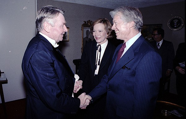President and Mrs. Jimmy Carter (right) greet Robert Shaw...
