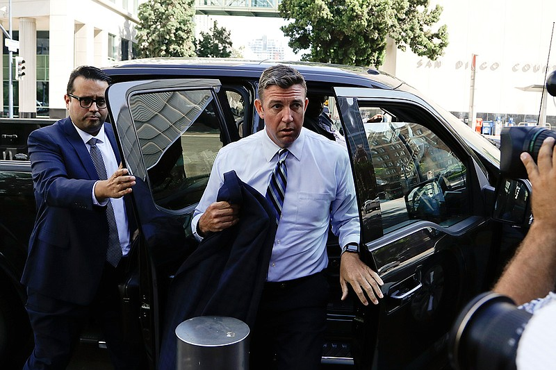 U.S. Rep. Duncan Hunter, center, arrives for an arraignment hearing Thursday,...