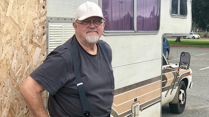 Mac Sperry stands next to his RV in Mission Bay, June 21, 2019.
