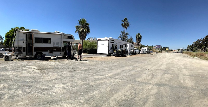 RVs are parked at the proposed location for a new homeless storage facility n...
