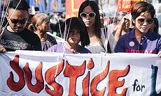 A scene from a rally for Jennifer Laude with a ...