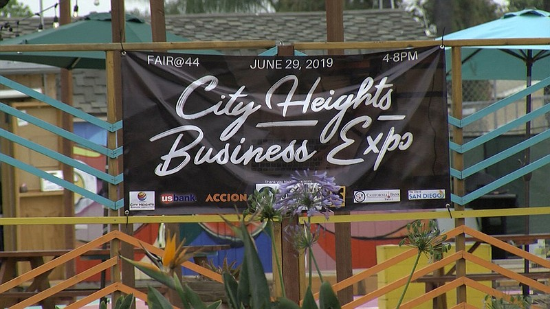 A sign is advertising the City Heights Business Expo at Fair@44 in San Diego ...