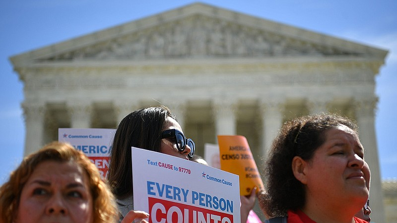 Demonstrators rally outside the U.S. Supreme Court in April to protest agains...
