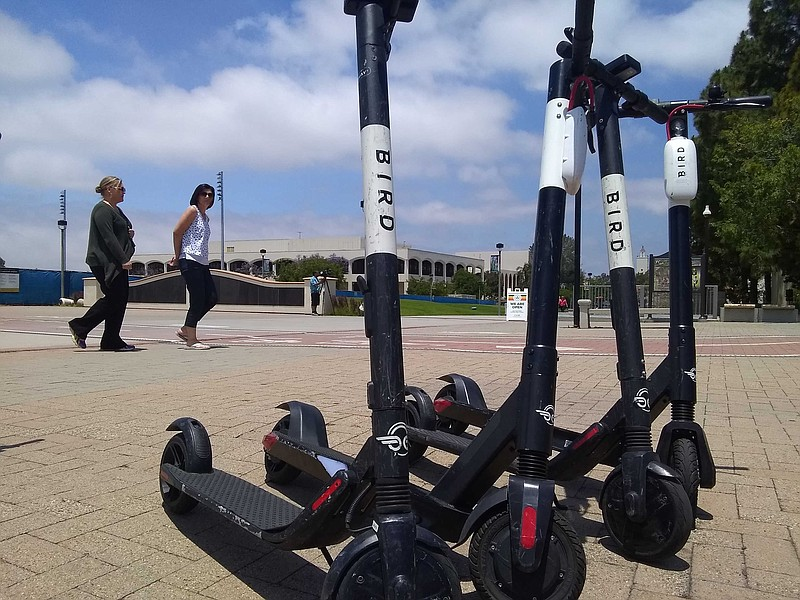 A group of Bird scooters parked at San Diego State University, June 2019.