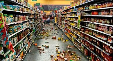 Food that fell from the shelves litters the floor of an aisle at a Walmart fo...