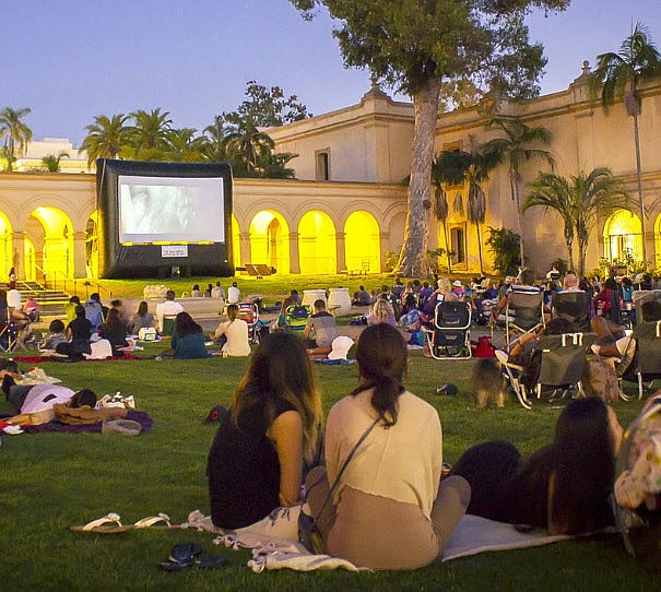 A film plays at San Diego Museum of Art's Screen on the Green movie night in ...