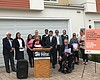 Housing advocates gather at a press conference ...