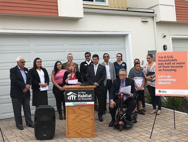Housing advocates gather at a press conference to support a $900 million hous...
