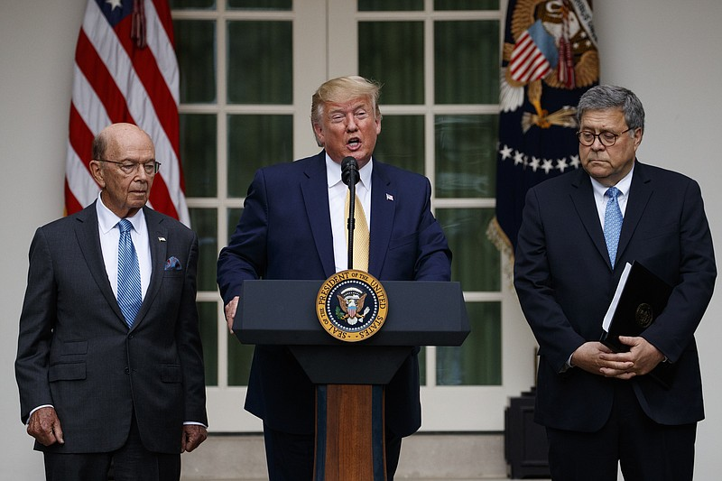 President Donald Trump, joined by Commerce Secretary Wilbur Ross, left, and A...