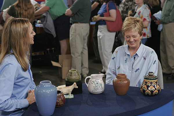 Suzanne Perrault (left) appraises a UND School of Mines c...