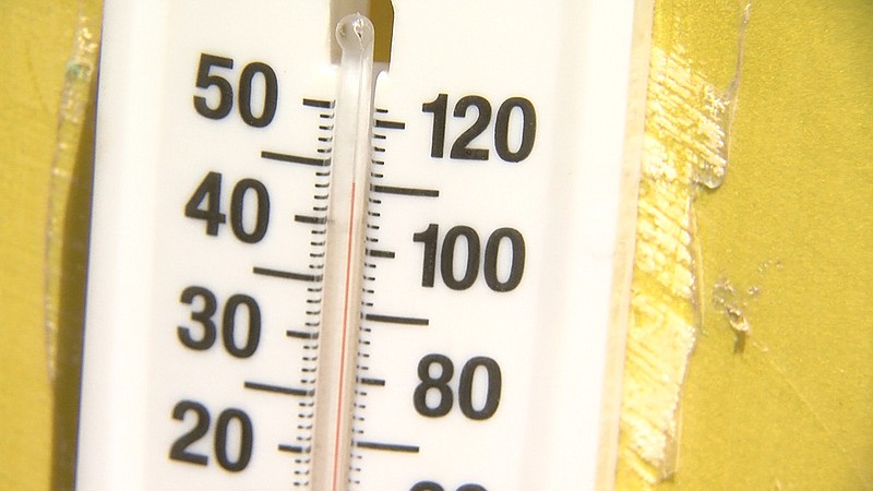 An outdoor thermometer shows the temperature well over 100 degrees at Cowles ...