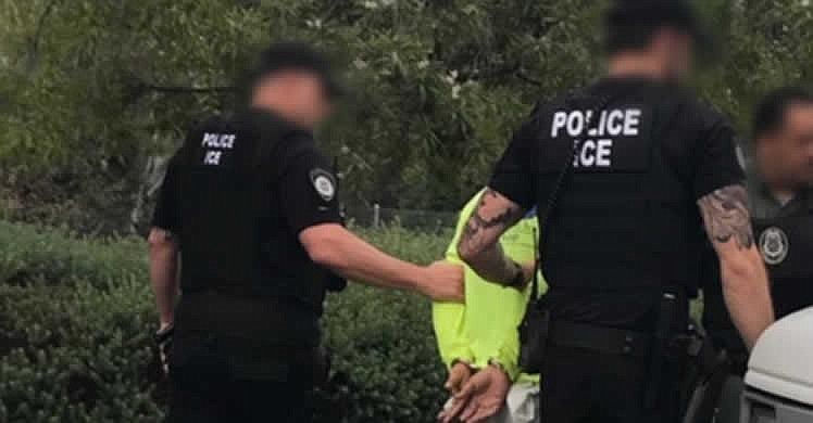 ICE officers arresting an undocumented immigrant during Operation Cross Check...