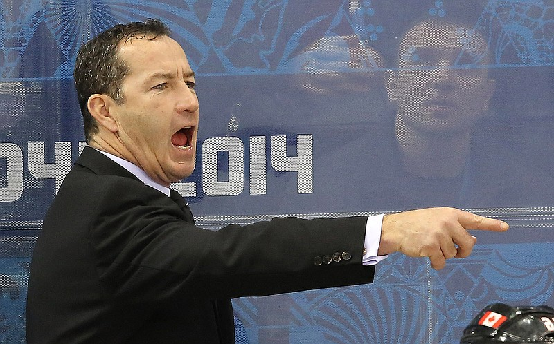 Team Canada Head Coach Kevin Dineen yells instructions to the ice during the ...
