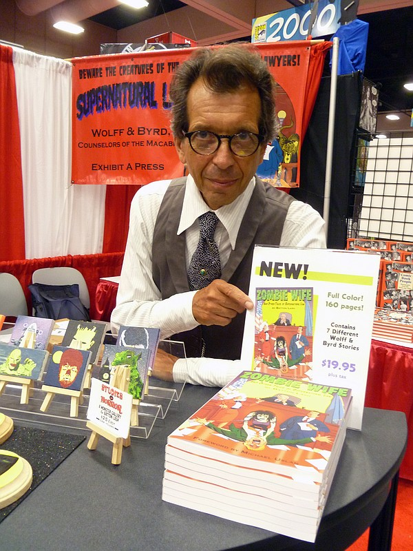 The late Batton Lash at his booth at Comic-Con.