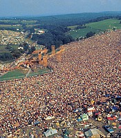 Aerial view of Woodstock festival attendees and stage, Bethel, N.Y., Aug. 1969.