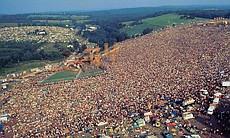 Aerial view of Woodstock festival attendees and...