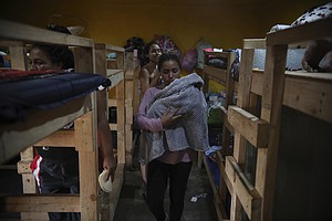 Teen Mom, Newborn Eye New Life From Tijuana Migrant Shelter