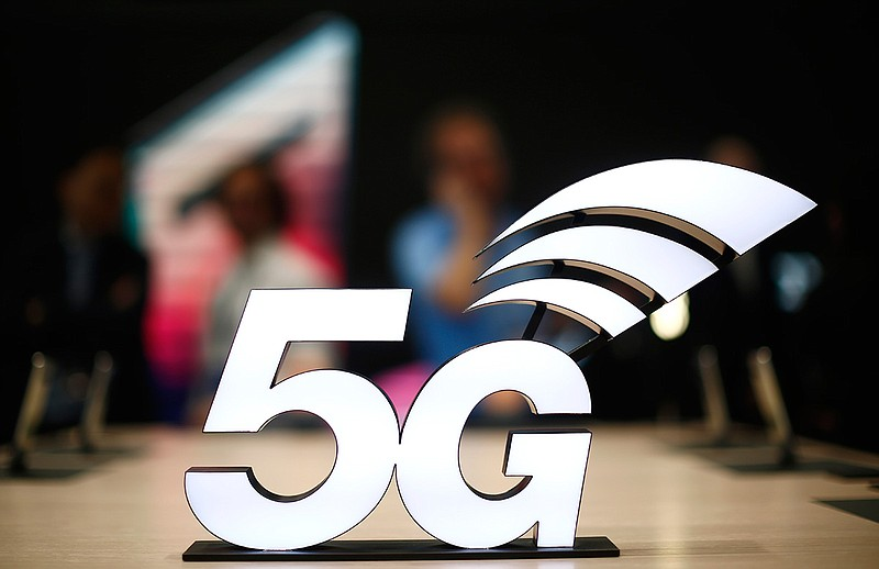 This Feb. 25, 2019 file photo shows a banner of the 5G network is displayed d...