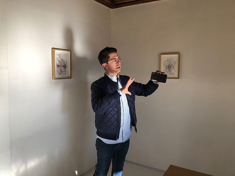 In this photo taken in March of 2019, Miguel Marshall stands inside the art g...