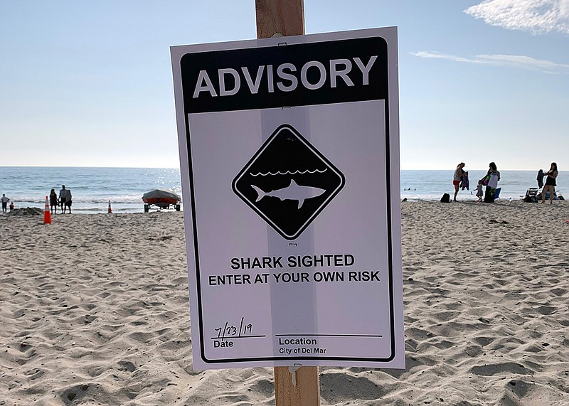 Shark sighting warning sign posted at a Del Mar beach on July 23, 2019, after...