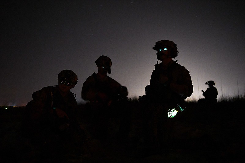 U.S. Navy Sea, Air, and Land Team Members conduct military field operations d...