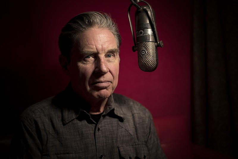 A 2019 photo of musician and author, John Doe.