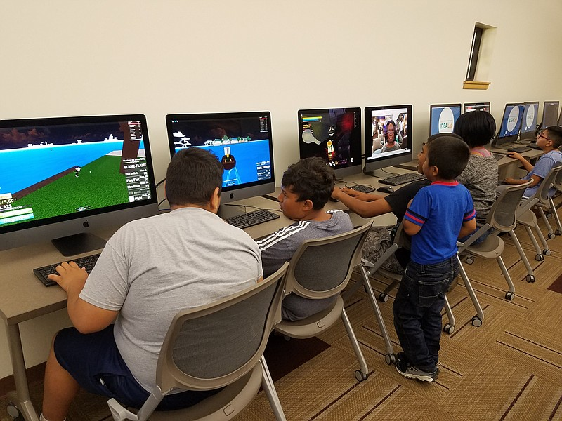 Teens use computers in new IdeaLab at Logan Heights library, July 29, 2019.