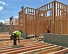 Construction crews work on a 24-unit apartment ...
