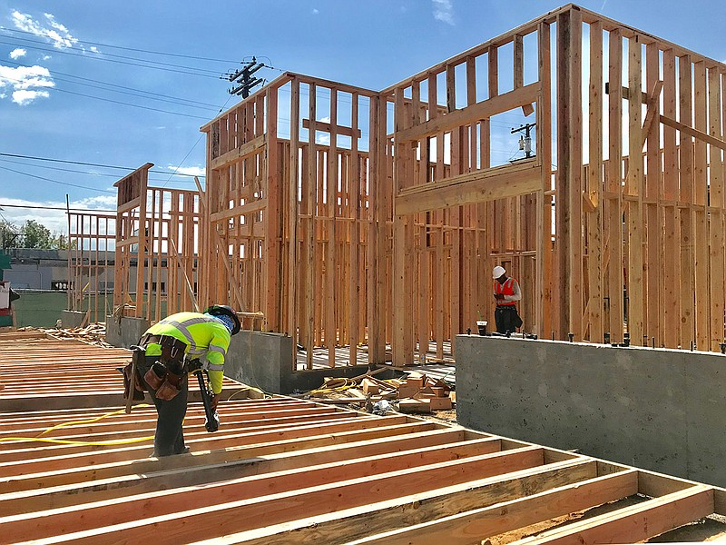 Construction crews work on a 24-unit apartment building in North Park, July 2...