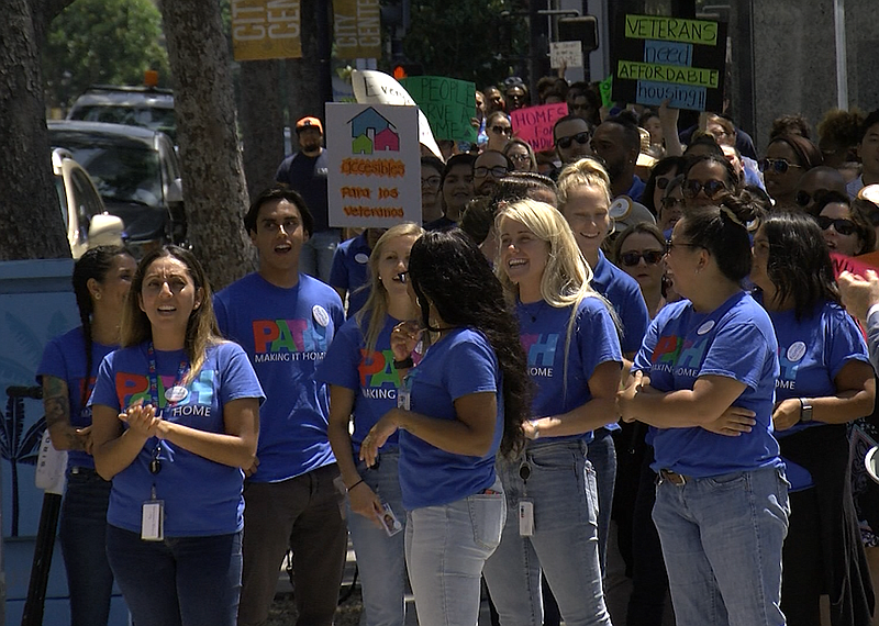 Supporters of an affordable housing bond measure march to the San Diego City ...